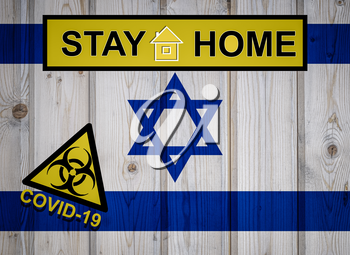 Flag of the Israel in original proportions. Quarantine and isolation - Stay at home. flag with biohazard symbol and inscription COVID-19.