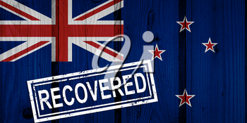 flag of New Zealand that survived or recovered from the infections of corona virus epidemic or coronavirus. Grunge flag with stamp Recovered