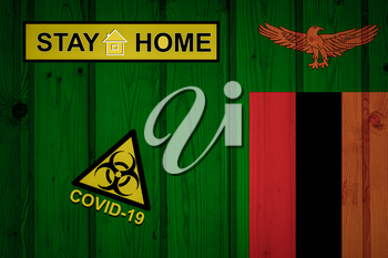 Flag of the Zambia in original proportions. Quarantine and isolation - Stay at home. flag with biohazard symbol and inscription COVID-19.