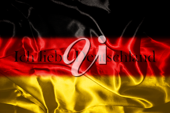 German flag blowing in the wind With Letters That Spell I Love Germany